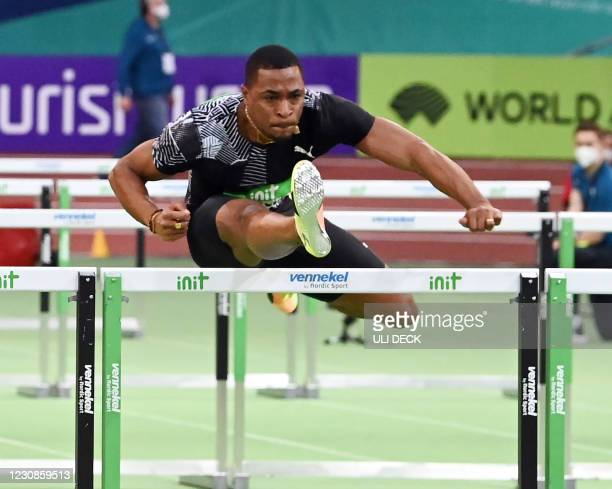 France's Wilhelm Belocian wins the 60m hurdles event at the IAAF World Indoor Athletics Championships in Karlsruhe, southern Germany, on January 29,...