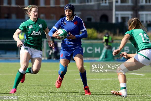 France's wing Caroline Boujard runs to score her second try during the Six Nations international women's rugby union match between Ireland and France...
