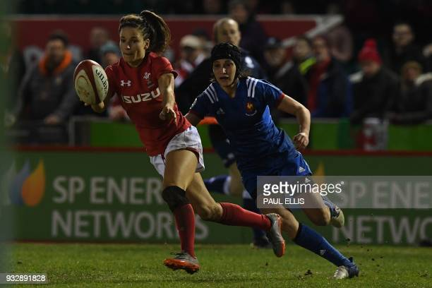 France's wing Caroline Boujard tackles Wales' wing Jasmine Joyce during the Women's Six Nations international rugby union match between Wales and...