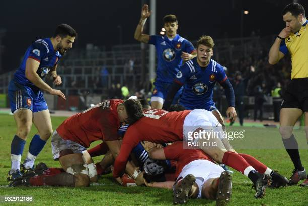 France's wing Clement Laporte scores his team's second try during the Under20 Six Nations international rugby union match between between Wales U20...
