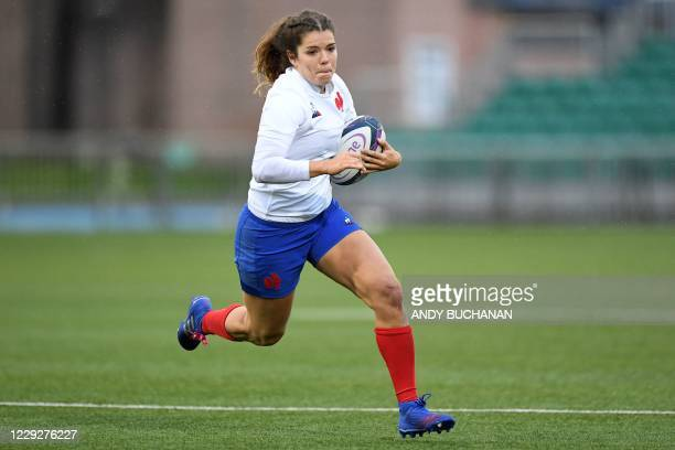France's wing Cyrielle Banet runs with the ball during the Women's Six Nations rugby union match between Scotland and France at Scotstoun Stadium in...