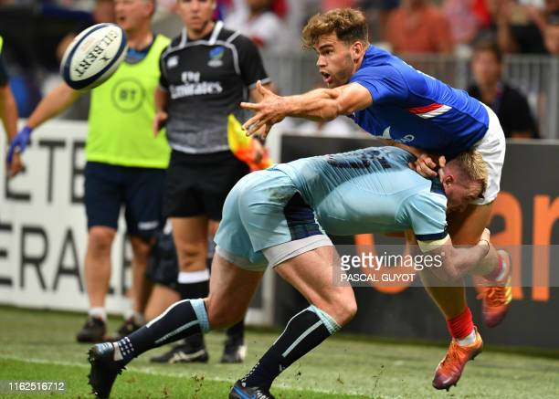 France's wing Damien Penaud fights for the ball with Scotland's Stuart Hogg during the 2019 Rugby World Cup warmup test match between France and...