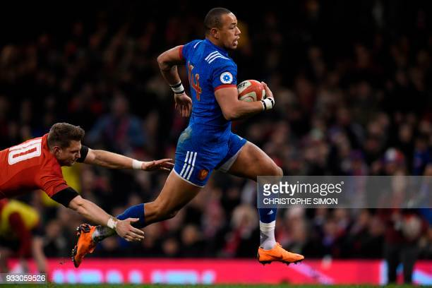 TOPSHOT France's wing Gael Fickou evades the tackle of Wales' flyhalf Dan Biggar during the Six Nations international rugby union match between Wales...