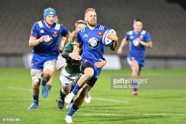 France's wing Maxime Marty runs with the ball during the Six Nations U20 rugby union match between France and Ireland at the ChabanDelmas Stadium in...