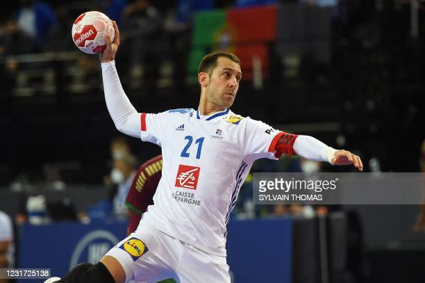 France's wing Michael Guigou takes a shot during the IHF Men's Tokyo Handball Qualification 2020 match between Portugal and France at the Sud de...