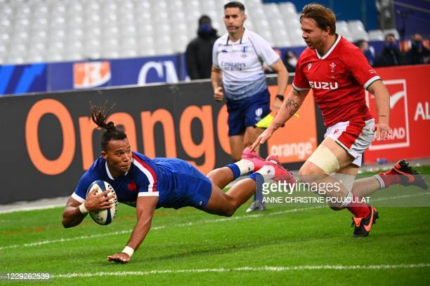 France's wing Teddy Thomas scores a try during the Autumn International rugby union test match between France and Wales, at the Stade de France in...