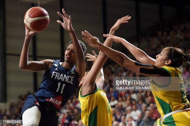 France's wing Valeriane Vukosavljevic fights for the ball with Brazilian's defender Taina Paixao during the FIBA Women's Olympic Qualifying...
