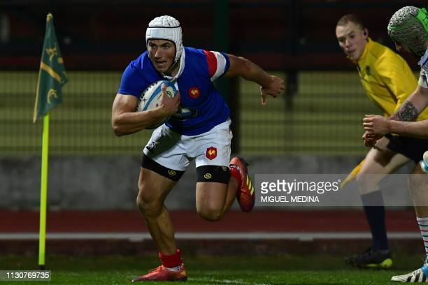 France's wing Vincent Pinto runs on his way to score a try during the Under20 Six Nations international rugby union match between Italy and France at...