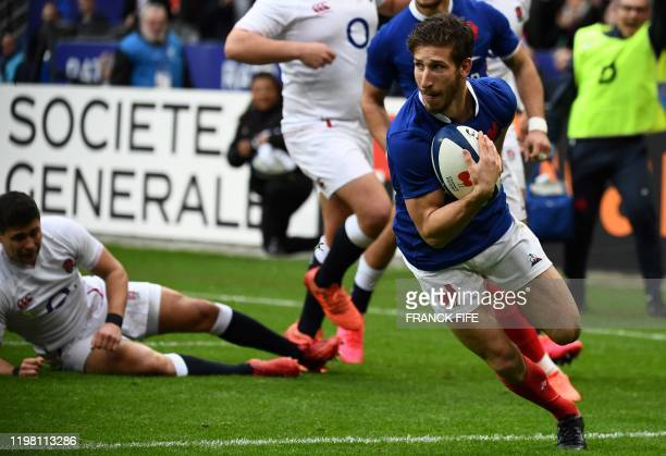 France's wing Vincent Rattez runs with the ball to score a try during the Six Nations rugby union tournament match between France and England at the...