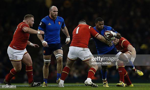 France's wing Virimi Vakatawa is tackeld by Wales' prop Rob Evans during the Six Nations international rugby union match between Wales and France at...