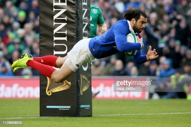 France's wing Yoann Huget dives over the line to score their first try during the Six Nations international rugby union match between Ireland and...