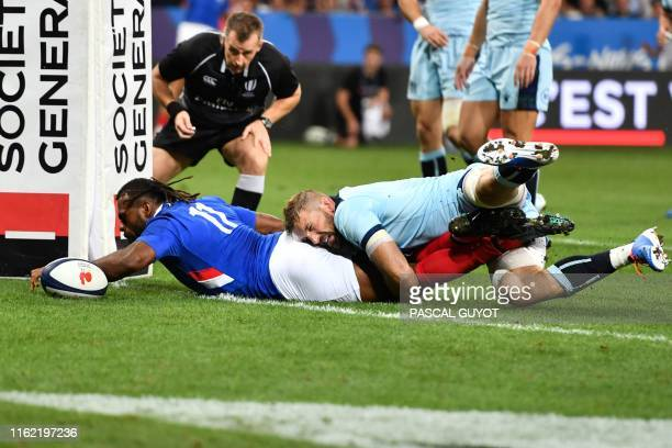 TOPSHOT France's winger Alivereti Raka dives across the line to score a try during the 2019 Rugby World Cup warmup test match between France and...