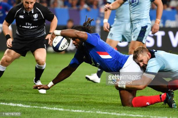 France's winger Alivereti Raka dives across the line to score a try during the 2019 Rugby World Cup warmup test match between France and Scotland at...