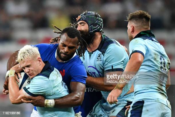 France's winger Alivereti Raka tackles Scotland's winger Darcy Graham during the 2019 Rugby World Cup warmup test match between France and Scotland...
