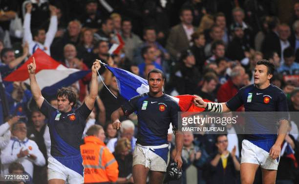 France's winger Christophe Dominici France's flanker Thierry Dusautoir and France's fullback Damien Traille celebrate at the end of the rugby union...