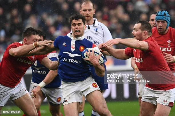 TOPSHOT France's winger Damian Penaud is tackled by Wales players during the Six Nations rugby union tournament match between France and Wales at the...