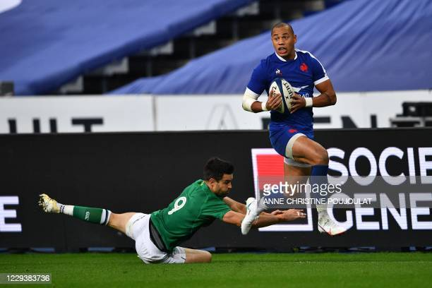 France's winger Gael Fickou runs with the ball during the Six Nations rugby union tournament match between France and Ireland at the stade de France,...