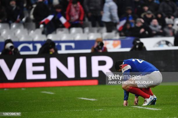 France's winger Geoffrey Doumayrou reacts at the end of the Six Nations rugby union tournament match between France and Wales at the stade de France...