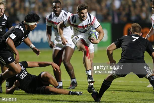 France's winger Lucas Tauzin runs with the ball during the U20 World Rugby union Championship semi-final match between France and New-Zealand at the...