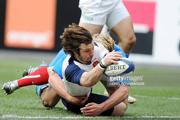 France's winger Marc Andreu scores a try despite the tackle of Italy's winger Mirco Bergamasco during the Six Nations tournament rugby union match...