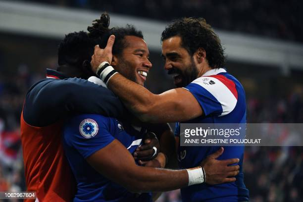 France's winger Teddy Thomas celebrates with France's winger Yoann Huget after scoring his second try during the international rugby union test match...
