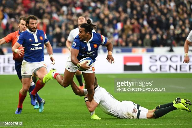 France's winger Teddy Thomas is is tackled by le South Africa's fullback Willem Le Roux during the international rugby union test match between...