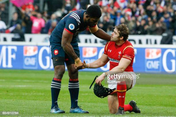 France's winger Virimi Vakatawa shake hands withWales' fullback Leigh Halfpenny at the end of the Six Nations tournament Rugby Union match between...