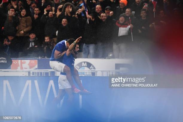 France's winger Yoann Huget celebrates with France's center Wesley Fofana after scoring a try during the Six Nations rugby union tournament match...