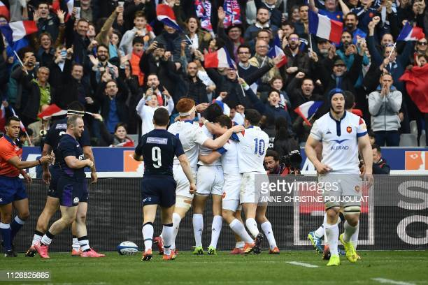 France's winger Yoann Huget celebrates with teammates after scoring a try during the Six Nations rugby union tournament match between France and...