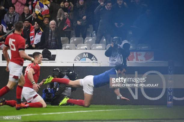 France's winger Yoann Huget scores a try during the Six Nations rugby union tournament match between France and Wales at the stade de France in Saint...