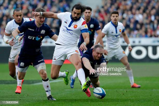France's winger Yoann Huget vies for the ball with Scotland's centre Nick Grigg during the Six Nations rugby union tournament match between France...