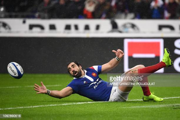 TOPSHOT France's winger Yoann Huguet fails to control the ball during the Six Nations rugby union tournament match between France and Wales at the...