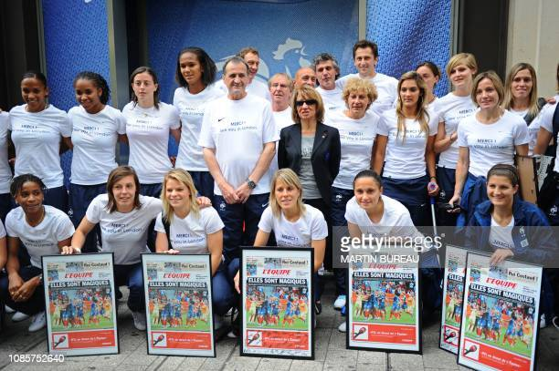 France's women national football team poses at the Nike store on the ChampsElysees avenue in Paris on July 18 2011 First row striker Elodie Thomis...