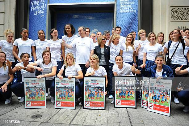France's women national football team poses at the Nike store on the ChampsElysees avenue in Paris on July 18 2011 First row Strikers Gaetane Thiney...