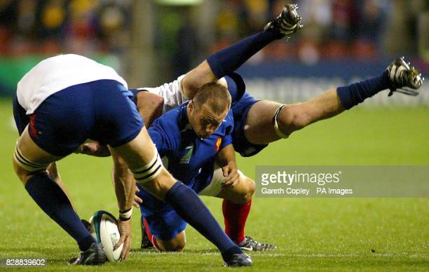 France's Yannick Bru loses the ball under pressure from USA's Luke Gross and Alec Parker during their Rugby Union World Cup pool match at WIN Stadium...