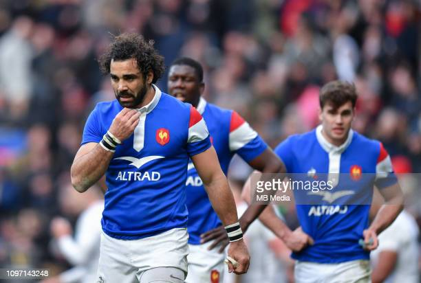 France's Yoann Huget dejected as England's Jonny May scores his sides third try at Twickenham Stadium on February 10 2019 in London England