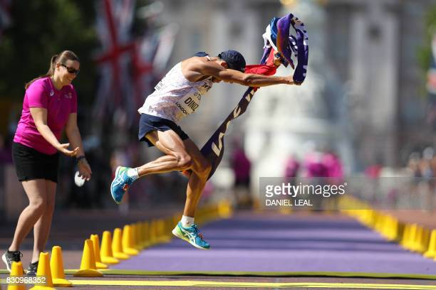 TOPSHOT France's Yohann Diniz wins the men's 50km race walk athletics event at the 2017 IAAF World Championships on The Mall in central London on...