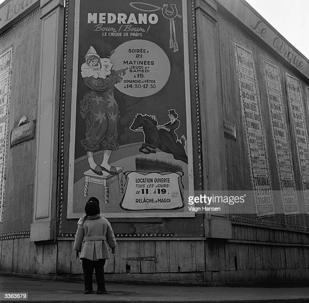 France's youngest clown Philip Pipo aged two and a half stares up at a poster for the Medrano Circus in Paris where Philip is performing with his...