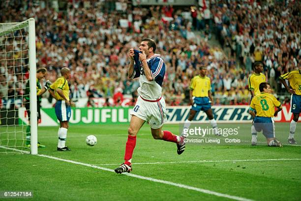 France's Zinedine Zidane celebrates scoring the second goal of the 1998 FIFA World Cup final against Brazil. France won 3-0. | Location: Saint Denis,...