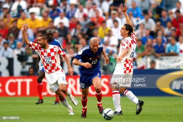 France's Zinedine Zidane is caught offside by Croatia's Nenad Bjelica and Tomo Sokota