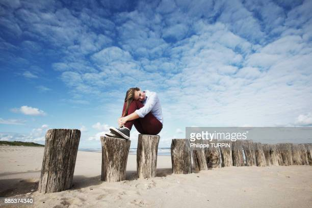 france,sad fair young woman on moles. - sadgirl stock pictures, royalty-free photos & images