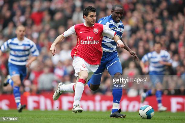 Francesc Fabregas of Arsenal battles with Ibrahima Sonko of Reading during the Barclays Premier League match between Arsenal and Reading at the...