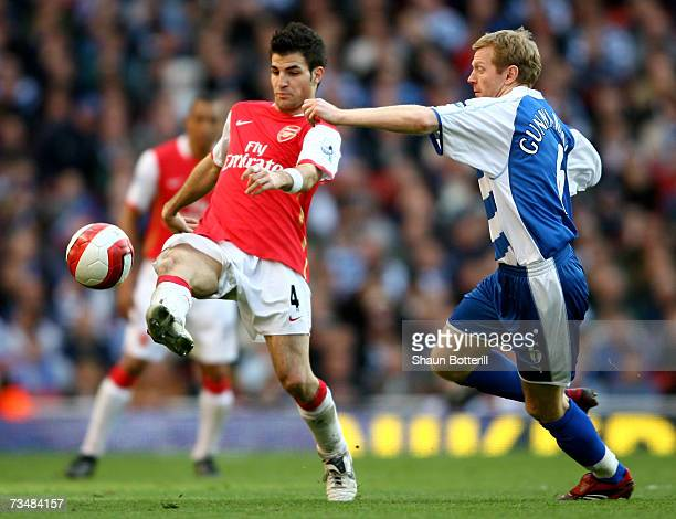 Francesc Fabregas of Arsenal holds off the challenge of Ivar Ingimarsson of Reading during the Barclays Premiership match between Arsenal and Reading...