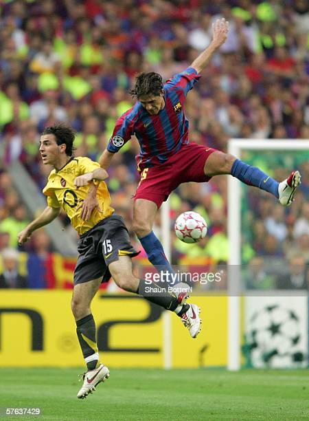 Francesc Fabregas of Arsenal is challenged by Edmilson of Barcelona during the UEFA Champions League Final between Arsenal and Barcelona at the Stade...