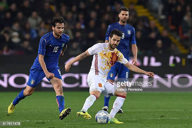 Francesc Fabregas of Spain in action against Marco Parolo of Italy during the international friendly match between Italy and Spain at Stadio Friuli...