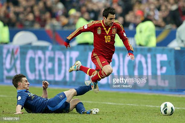 Francesc Fabregas of Spain is brought down by Laurent Koscielny of France during a FIFA 2014 World Cup Qualifier between France and Spain at Stade de...