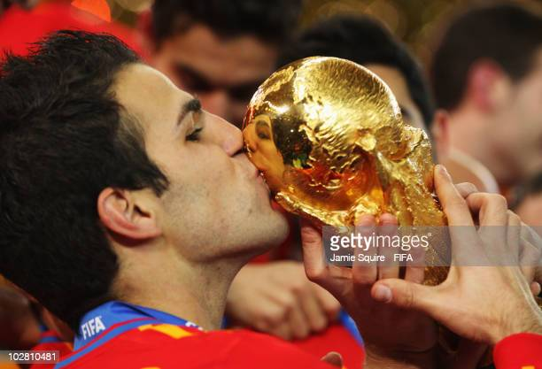 Francesc Fabregas of Spain kisses the World Cup after the 2010 FIFA World Cup South Africa Final match between Netherlands and Spain at Soccer City...