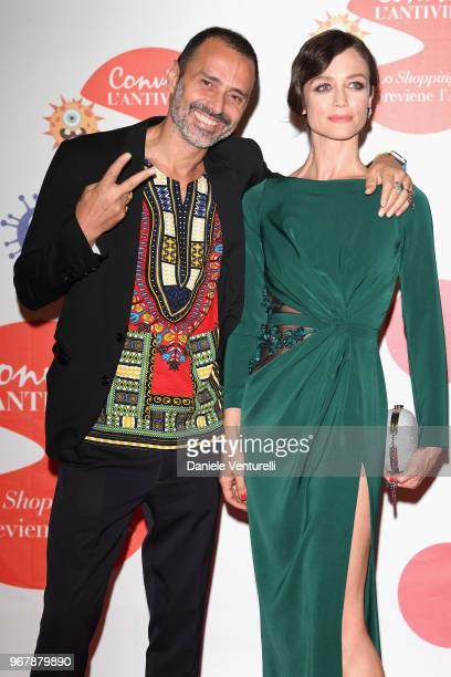 Francesca Cavallin and a guest attend Convivio photocall on June 5 2018 in Milan Italy