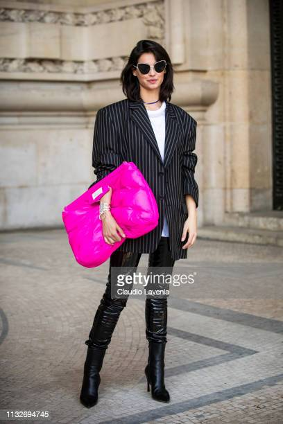 Francesca Chillemi wearing a white top striped blazer black leather pants black shoes and hot pink bag is seen outside Maison Margiela on Day 3 Paris...