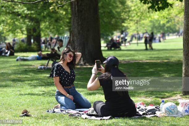 Francesca Coppola poses for a friend while enjoying the sunshine in St James's Park on April 22 2019 in London England This Easter weekend has broken...
